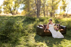 bride on couch in woods