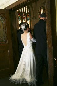 bride bening escourted down the isle