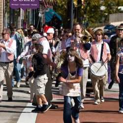 Zombies walk down littleton Blvd for pig roast.