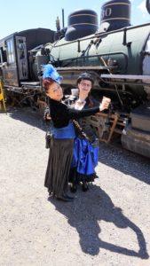 Steampunk girls dance by train