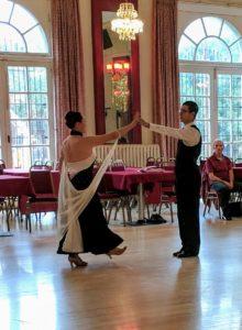 Standard ballroom dancers take hold