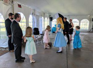 Alice greets girls