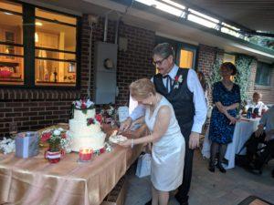 steve and rita cut the cake