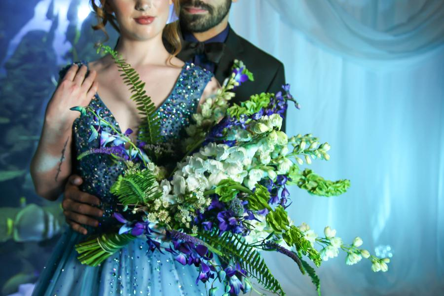 Closeup of couple with bouquet