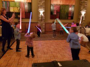 mother son light saber lesson