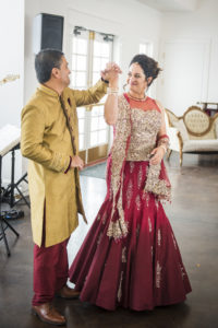 Gold indian groom, red wedding gown
