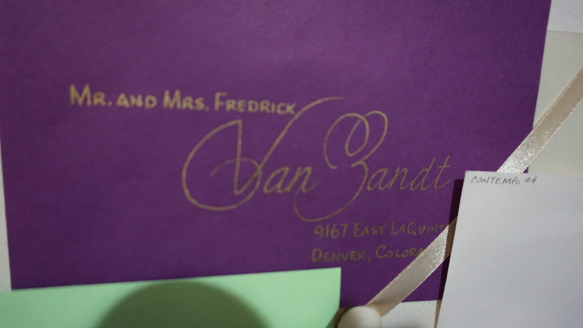 Gold calligraphy on purple envelope