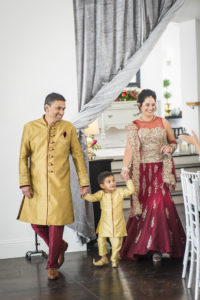 indian wedding couple and son