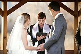 Reverend Kim Tavendale performing a wedding ceremony for a bride and groom