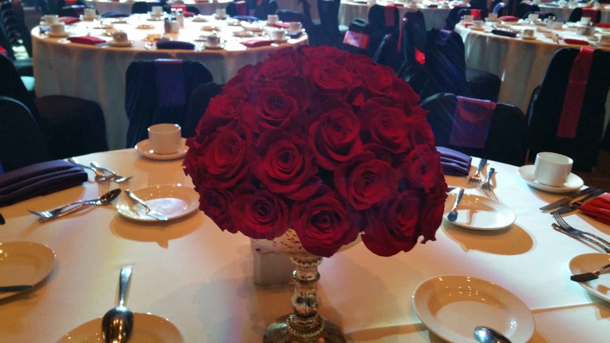 Wedding centerpiece with red roses